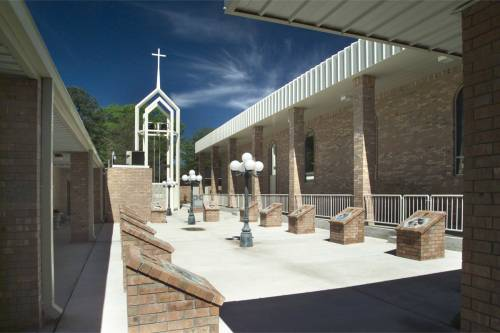 The left side of the church & Stations of the Cross Garden